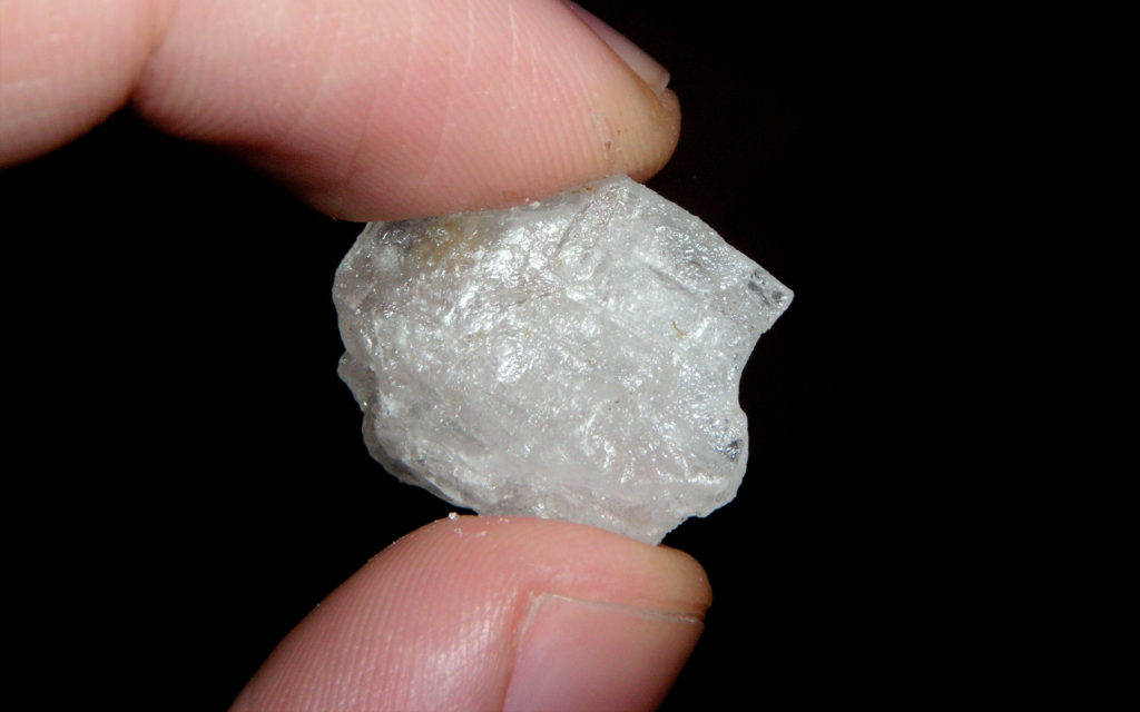 person holding crystal meth