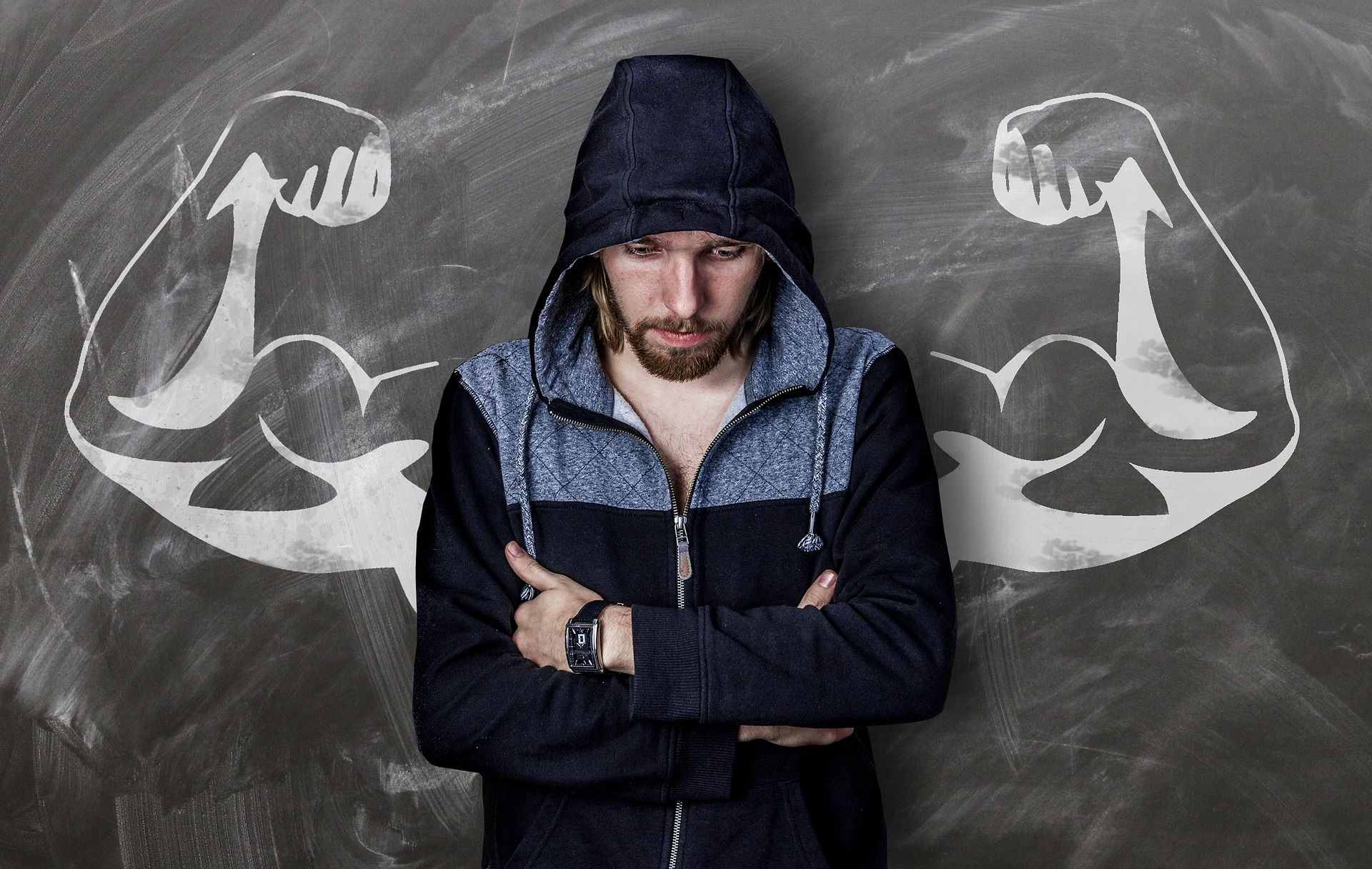 Man with drawing of strong arms behind him. Represents addiction relapse not being the end.